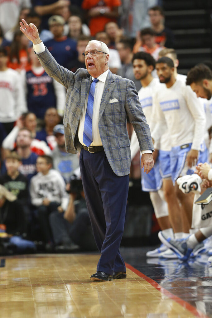 North Carolina head coach Roy Williams directs his team during the first half of an NCAA college basketball game in Richmond, Va., Sunday, Dec. 8, 2019. (AP Photo/Steve Helber)