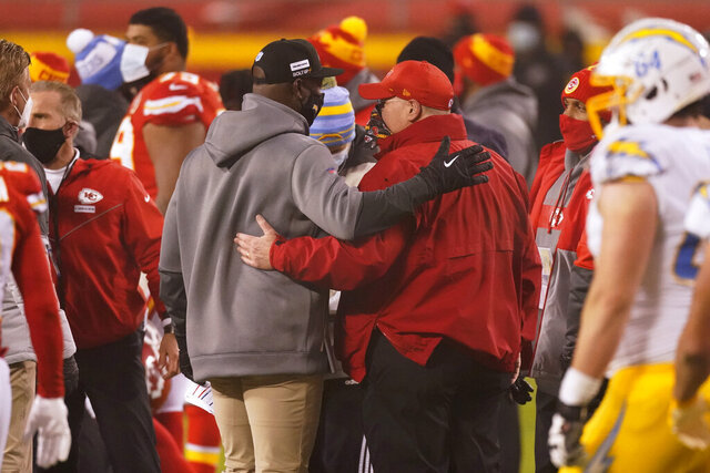 Los Angeles Chargers head coach Anthony Lynn, left, talks with Kansas City Chiefs head coach Andy Reid after an NFL football game, Sunday, Jan. 3, 2021, in Kansas City. The Chargers won 38-21. (AP Photo/Charlie Riedel)