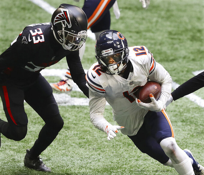 Chicago Bears wide receiver Allen Robinson II (12) breaks away from Atlanta Falcons cornerbacks Blidi Wreh-Wilson for a touchdown during the fourth quarter of an NFL football game Sunday, Sept. 27, 2020, in Atlanta. (Curtis Compton/Atlanta Journal-Constitution via AP)