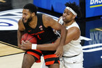 Colorado's Evan Battey (21) tries to steal the ball from Oregon State's Maurice Calloo (1) during the first half of an NCAA college basketball game in the championship of the Pac-12 men's tournament Saturday, March 13, 2021, in Las Vegas. (AP Photo/John Locher)