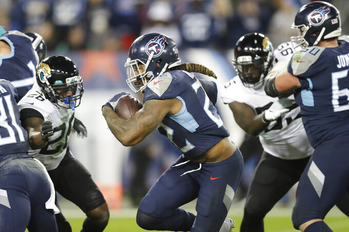 Tennessee Titans running back Derrick Henry (22) runs for a 7-yard touchdown against the Jacksonville Jaguars in the second half of an NFL football game Sunday, Nov. 24, 2019, in Nashville, Tenn. (AP Photo/James Kenney)