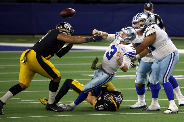 Pittsburgh Steelers' Stephon Tuitt, left, and linebacker T.J. Watt (90) pressure Dallas Cowboys quarterback Garrett Gilbert (3) who throws a pass to Ezekiel Elliott (21) as center Joe Looney (73) and guard Connor Williams, right rear, look on during the play in the second half of an NFL football game in Arlington, Texas, Sunday, Nov. 8, 2020. (AP Photo/Ron Jenkins)