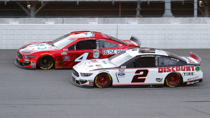 Harvick denies Keselowski in overtime at Michigan