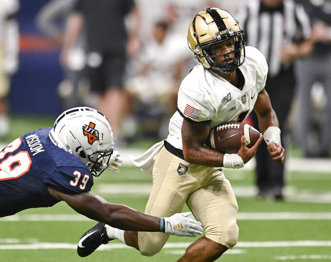 Army quarterback Jabari Laws, right, evades UTSA's Rashad Wisdom during the first half of an NCAA college football game Saturday, Sept. 14, 2019, in San Antonio. (AP Photo/Darren Abate)