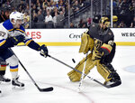 St. Louis Blues left wing David Perron (57) shoots the puck against Vegas Golden Knights goaltender Marc-Andre Fleury during the first period of an NHL hockey game Friday, Nov. 16, 2018, in Las Vegas. (AP Photo/David Becker)