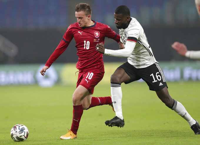 Germany's Antonio Rudiger, right, challenges Czech Republic's Jan Kopic during their friendly soccer match in Leipzig, Germany, Wednesday, Nov. 11, 2020. (AP Photo/Michael Sohn)