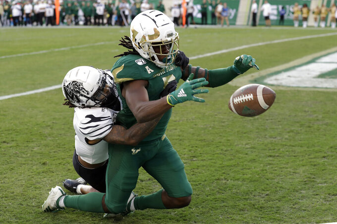 South Florida wide receiver Randall St. Felix (5) can't make the catch as he is taken down by Memphis defensive back T.J. Carter during the first half of an NCAA college football game Saturday, Nov. 23, 2019, in Tampa, Fla. (AP Photo/Chris O'Meara)