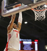 Dayton's Obi Toppin (1) dunks during the first half of an NCAA college basketball game against Fordham, Saturday, Feb. 1, 2020, in Dayton, Ohio. (AP Photo/Tony Tribble)