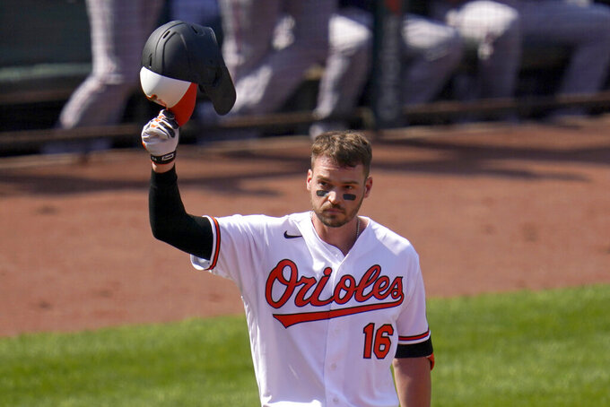 Baltimore Orioles' Trey Mancini tips his helmet as fans give him a standing ovation prior to batting against the Boston Red Sox during the first inning of a baseball game, Thursday, April 8, 2021, on Opening Day in Baltimore. (AP Photo/Julio Cortez)