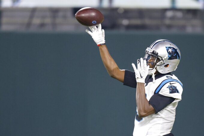 Carolina Panthers quarterback Teddy Bridgewater warms up before an NFL football game against the Green Bay Packers Saturday, Dec. 19, 2020, in Green Bay, Wis. (AP Photo/Matt Ludtke)