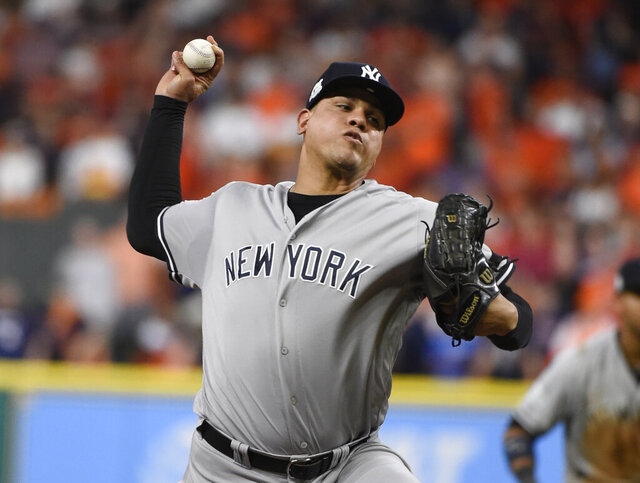 FILE - In this Oct. 20, 2017, file photo, New York Yankees relief pitcher Dellin Betances throws during the eighth inning of Game 6 of baseball's American League Championship Series against the Houston Astros in Houston. The New York Mets have reached an agreement with free-agent reliever Betances on a one-year contract with a player option for 2021. The Mets announced the deal with four-time All Star on Tuesday, Dec. 24, 2019. (AP Photo/Eric Christian Smith, File)