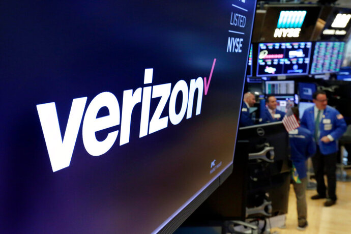 FILE - This April 23, 2018, file photo shows the logo for Verizon above a trading post on the floor of the New York Stock Exchange. Verizon is selling Tumblr, a darling of early social media, to the owner of blogging platform WordPress. (AP Photo/Richard Drew, File)