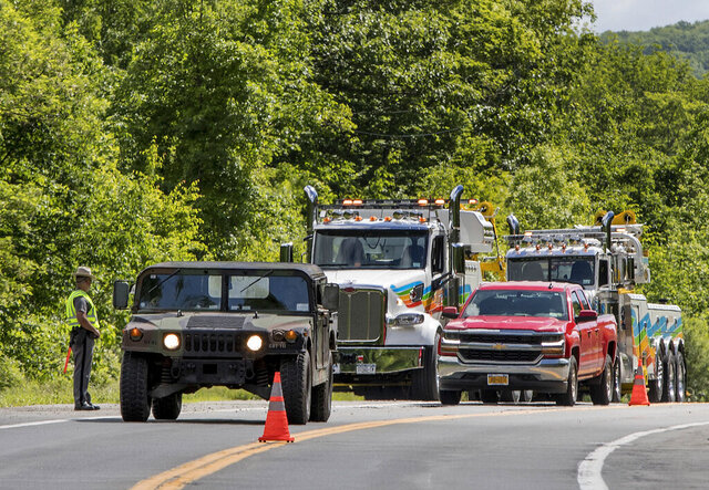 FILE - In this June 6, 2019, file photo, military police direct traffic along Route 293 near the site where an armored personnel vehicle overturned and killed a West Point cadet killing in Cornwall, N.Y.  Staff Sgt. Ladonies Strong, an Army soldier based in Georgia, will face a trial by court-martial after being charged in the vehicle rollover, a Fort Stewart spokesman said Wednesday, Dec. 11.  (AP Photo/Allyse Pulliam, File)