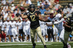 Wake Forest quarterback Jamie Newman throws a pass against Elon in the first half of an NCAA college football game in Winston-Salem, N.C., Saturday, Sept. 21, 2019. Wake Forest won 49-7. (AP Photo/Nell Redmond)