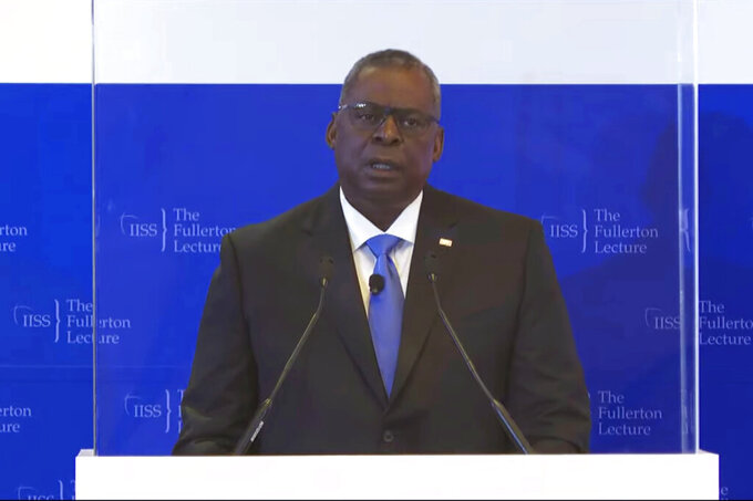 In this image from video provided by IISS, U.S. Defense Secretary Lloyd J. Austin delivers a speech during the 40th IISS Fullerton Lecture Tuesday, July 27, 2021 in Singapore. Austin decried the actions of Myanmar's military rulers as unacceptable on Tuesday, while urging a regional bloc to keep demanding an end to violence. Austin also applauded the Association of Southeast Asian nations for its efforts on the issue, which included forging a consensus with Myanmar's military leader in April. (IISS via AP)