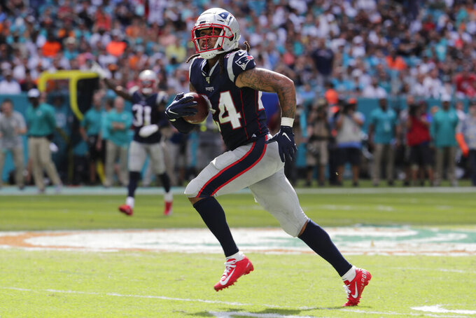 New England Patriots cornerback Stephon Gilmore (24) looks up as he runs for the end zone for a touchdown, during the second half at an NFL football game against the Miami Dolphins, Sunday, Sept. 15, 2019, in Miami Gardens, Fla. (AP Photo/Lynne Sladky)