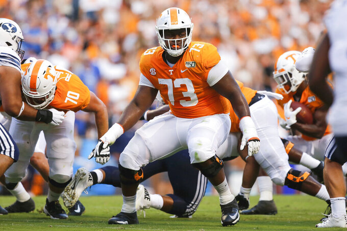 FILE - In this Sept. 7, 2019, file photo, Tennessee offensive lineman Trey Smith (73) plays against BYU during an NCAA football game in Knoxville, Tenn. Trey Smith was selected to The Associated Press preseason All-America first-team, Tuesday, Aug. 25, 2020.  (C.B. Schmelter/Chattanooga Times Free Press via AP, File)