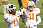 Tennessee defensive back Bryce Thompson (0) and Henry To'o To'o (11) celebrate the team's 31-27 win over South Carolina in an NCAA college football game Saturday, Sept. 26, 2020, in Columbia, S.C. (AP Photo/Sean Rayford)