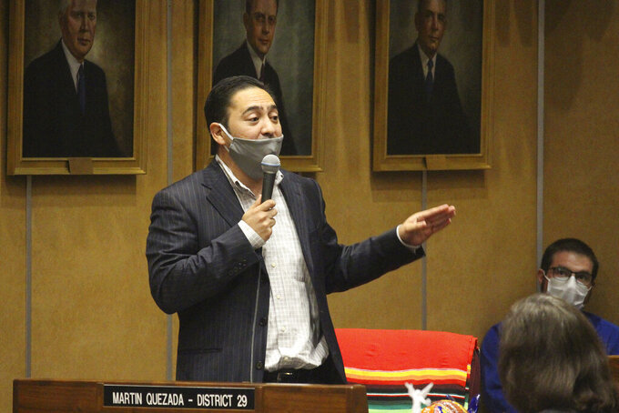 """FILE - In this May 8, 2020, file photo Democratic state Sen. Martin Quezada urges speaks at the state Capitol in Phoenix. Arizona and Texas are both in the final stages of work on contentious pieces of state legislation to tighten voting laws. Quezada, a Latino from Phoenix, didn't back down. """"This will hurt my community. This will hurt my neighborhood."""" (AP Photo/Bob Christie, File)"""