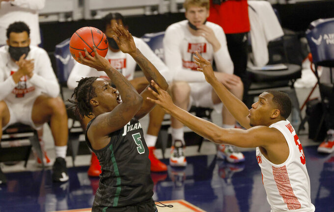 Tulane forward Kevin Cross (5) goes up to shoot as Houston forward Fabian White Jr. (35) defends during the first half of an NCAA college basketball game in the quarterfinal round of the American Athletic Conference men's tournament Friday, March 12, 2021, in Fort Worth, Texas. (AP Photo/Ron Jenkins)