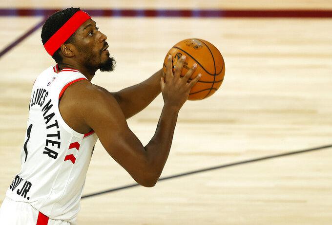 Toronto Raptors' Paul Watson shoots  during the third quarter against the Denver Nuggets in an NBA basketball game Friday, Aug. 14, 2020, in Lake Buena Vista, Fla. (Mike Ehrmann/Pool Photo via AP)