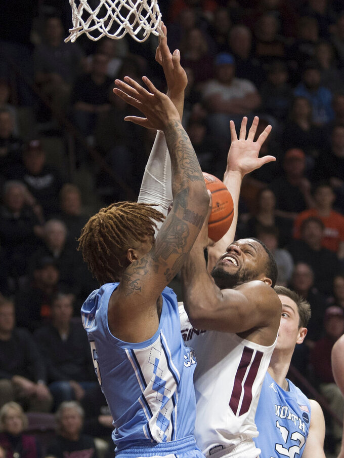 Virginia Tech shooter P.J. Horne gets double teamed by North Carolina during the secondhalf of an NCAA college basketball game in Blacksburg, Va., Wednesday, Jan. 22, 2020.(AP Photo/Lee Luther Jr.)
