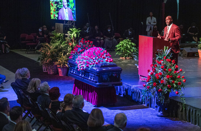 Derrick Brooks, an All American linebacker for Florida State and 11-time Pro Bowler for the Tampa Bay Buccaneers, eulogizes longtime Florida State University football coach Bobby Bowden as he lies in repose at the Tucker Civic Center, during a public celebration of life, Saturday, Aug. 14, 2021, in Tallahassee, Fla. Bowden became the FSU football coach in 1976, transforming the program into one of the best in the country. He coached FSU to national championships in 1993 and 1999. Bowden was 91. (AP Photo/Mark Wallheiser)