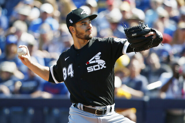 Chicago White Sox's Dylan Cease (84) pitches in the third inning of a spring training baseball game against the Milwaukee Brewers, Wednesday, March 4, 2020, in Phoenix, Ariz. (AP Photo/Sue Ogrocki)