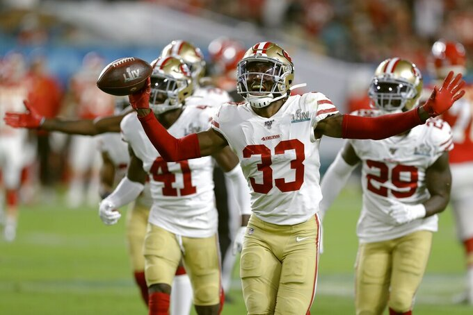 San Francisco 49ers' Tarvarius Moore celebrates his interception against the Kansas City Chiefs with teammates during the second half of the NFL Super Bowl 54 football game Sunday, Feb. 2, 2020, in Miami Gardens, Fla. (AP Photo/Chris O'Meara)