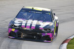 Jimmie Johnson (48) drives during a NASCAR Cup Series auto race Wednesday, June 10, 2020, in Martinsville, Va. (AP Photo/Steve Helber)