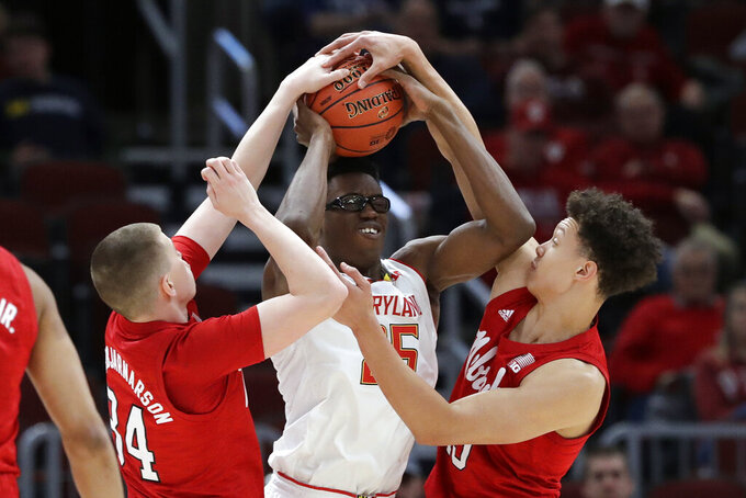 Nebraska's Thorir Thorbjarnarson (34) and Isaiah Roby (15) blocks a shot by Maryland's Jalen Smith (25) during the first half of an NCAA college basketball game in the second round of the Big Ten Conference tournament, Thursday, March 14, 2019, in Chicago. (AP Photo/Nam Y. Huh)