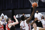 Washington State guard TJ Bamba (5) shoots in front of Utah center Branden Carlson (35) during the second half of an NCAA college basketball game in Pullman, Wash., Thursday, Jan. 21, 2021. (AP Photo/Young Kwak)