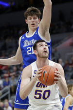 Northern Iowa's Austin Phyfe (50) looks to the basket as Drake's Liam Robbins (21) defends during the second half of an NCAA college basketball game in the quarterfinal round of the Missouri Valley Conference men's tournament Friday, March 6, 2020, in St. Louis. (AP Photo/Jeff Roberson)