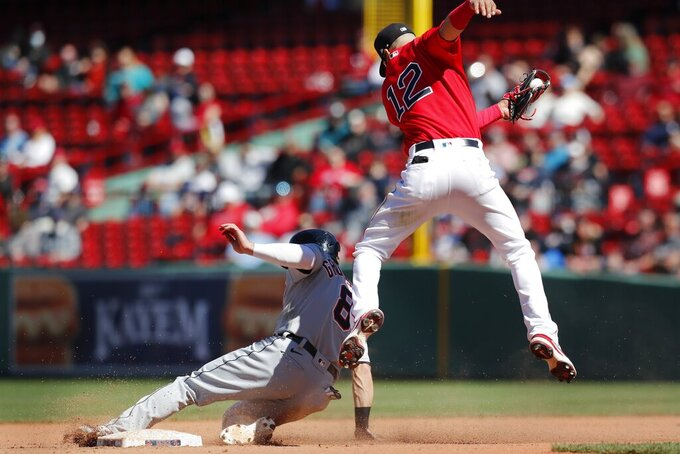 Detroit Tigers' Robbie Grossman (8) steals second base ahead of the throw to Boston Red Sox's Marwin Gonzalez (12) during the sixth inning of a baseball game, Thursday, May 6, 2021, in Boston. (AP Photo/Michael Dwyer)