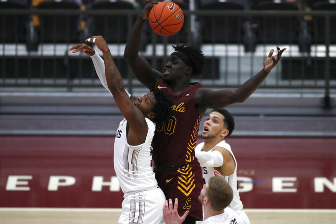 Loyola Chicago forward Aher Uguak, top, reaches for a loose ball as Southern Illinois' Lance Jones, left, tries to block during the second half of an NCAA college basketball game Saturday, Feb. 27, 2021, in Chicago.  (AP Photo/Shafkat Anowar)