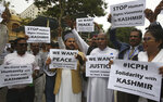 Activists of Pakistan's Interfaith Commission for Peace and Harmony protest against India, in Karachi, Pakistan, Thursday, Aug. 8, 2019. Pakistan's federal minister for railways said Thursday that Islamabad has suspended a key train service with neighboring India over change in Kashmir's special status by New Delhi. (AP PhotoFareed Khan)