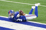 New York Giants' Dante Pettis loses the ball after crossing the goal line for a touchdown during the first half of an NFL football game against the Dallas Cowboys, Sunday, Jan. 3, 2021, in East Rutherford, N.J. (AP Photo/Corey Sipkin)