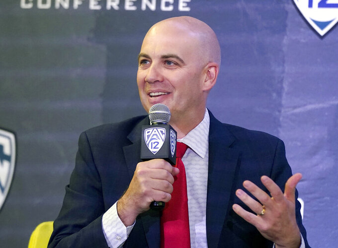 FILE - In this Oct. 13, 2021, file photo, Utah head coach Craig Smith speaks during the Pac-12 Conference NCAA college basketball media day in San Francisco. Smith, who is entering his first season at Utah after successful stints at Utah State and South Dakota, wants to reintroduce a fast-paced style of basketball to the team's program. Push the pace, take high percentage shots, and play tough defense.  Utah returns seven players from last season. Only two returning players – Riley Battin and Branden Carlson – saw significant playing time. (AP Photo/Jeff Chiu, File)