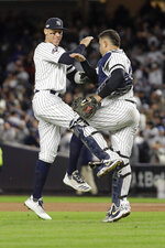 New York Yankees right fielder Aaron Judge, left, celebrates with catcher Gary Sanchez (24) after the Yankees beat the Houston Astros 4-1 in Game 5 of baseball's American League Championship Series, Friday, Oct. 18, 2019, in New York. (AP Photo/Frank Franklin II)
