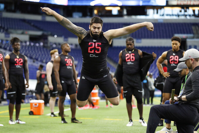 Iowa defensive lineman A J Epenesa (25) participates in a drill at the NFL football scouting combine in Indianapolis, Saturday, Feb. 29, 2020. (AP Photo/Charlie Neibergall)