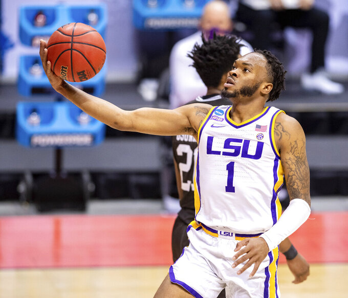 LSU guard Ja'Vonte Smart (1) shoots a layup during the second half of a first round game against St. Bonaventure in the NCAA men's college basketball tournament, Saturday, March 20, 2021, at Assembly Hall in Bloomington, Ind. (AP Photo/Doug McSchooler)