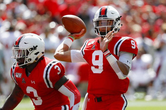 Cincinnati quarterback Desmond Ridder (9) passes in the first half of an NCAA college football game against Miami of Ohio, Saturday, Sept. 14, 2019, in Cincinnati. (AP Photo/John Minchillo)