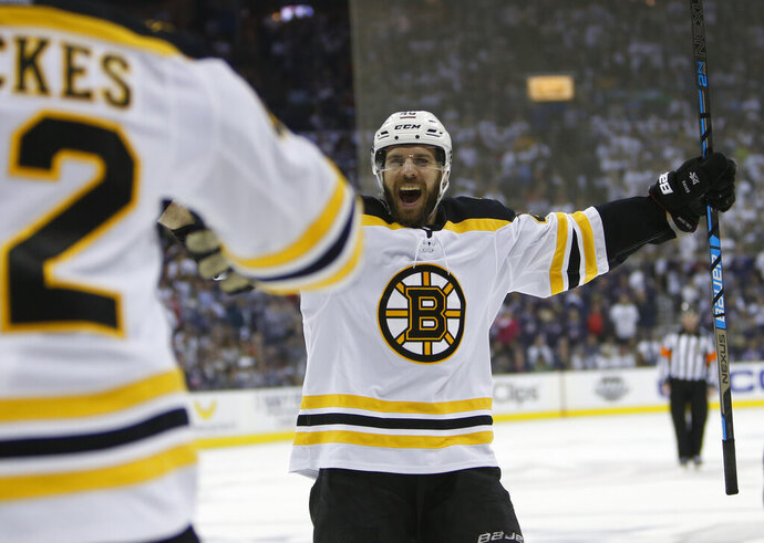 Boston Bruins' David Krejci, of the Czech Republic, celebrates a goal against the Columbus Blue Jackets during the third period of Game 6 of an NHL hockey second-round playoff series Monday, May 6, 2019, in Columbus, Ohio. (AP Photo/Jay LaPrete)