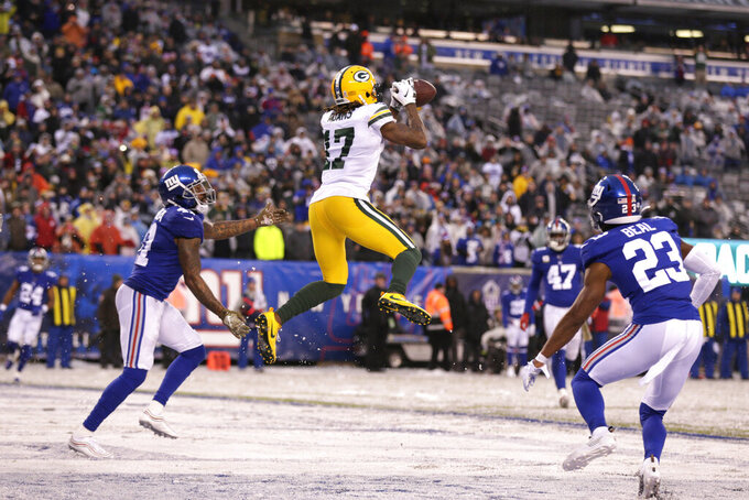 Green Bay Packers' Davante Adams (17) catches a touchdown pass during the second half of an NFL football game against the New York Giants, Sunday, Dec. 1, 2019, in East Rutherford, N.J. (AP Photo/Adam Hunger)