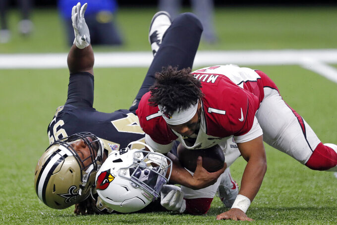 Arizona Cardinals quarterback Kyler Murray (1) loses his helmet as he is sacked by New Orleans Saints defensive end Cameron Jordan (94) in the second half of an NFL football game in New Orleans, Sunday, Oct. 27, 2019. (AP Photo/Bill Feig)