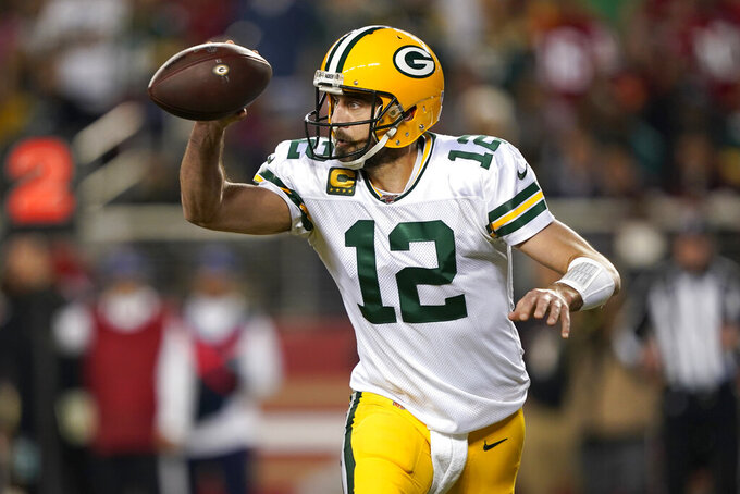 Green Bay Packers quarterback Aaron Rodgers (12) looks to pass against the San Francisco 49ers during the first half of an NFL football game in Santa Clara, Calif., Sunday, Nov. 24, 2019. (AP Photo/Tony Avelar)