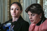 Teala Davies, left, listens to her attorney Gloria Allred, right, speak news conference, Thursday, Nov. 21, 2019, in New York, about the filing of a lawsuit against the estate of Jeffrey Epstein. Davies says she was 17 when she was victimized by Epstein. (AP Photo/Jeenah Moon)