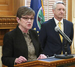 Kansas Gov. Laura Kelly, left, introduces Jeffry Jack, right, as her nominee for a seat on the state Court of Appeals, during a news conference, Friday, March 15, 2019, at the Statehouse in Topeka, Kan. . Jack is a Labette County district court judge who previously served in the Kansas House. (AP Photo/John Hanna)