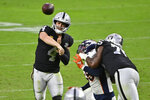 Las Vegas Raiders quarterback Derek Carr (4) throws against the Denver Broncos during the second half of an NFL football game, Sunday, Nov. 15, 2020, in Las Vegas. (AP Photo/David Becker)