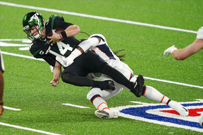 New York Jets quarterback Sam Darnold (14) is sacked by Denver Broncos' A.J. Johnson during the first half of an NFL football game Thursday, Oct. 1, 2020, in East Rutherford, N.J. (AP Photo/John Minchillo)